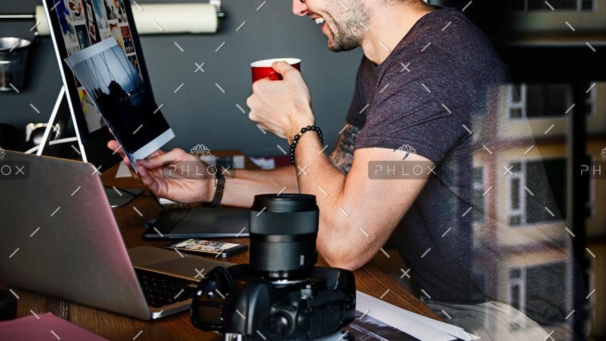 demo-attachment-485-photographer-journalist-working-studion-agency-PWTYFR5